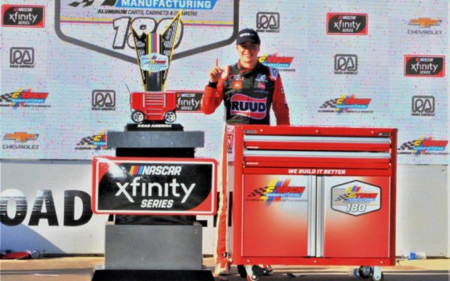 Christopher Bell poses with the winning hardware at Road America.  [Dave Jensen Photo]