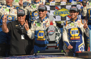 Winner's circle with owner Rick Hendrick, crew chief Alan Gustafson and winner Chase Elliott. All three ar holding up two fingers in celebration of 2nd consecutive win at Watkins Glen. [Joe Jennings Photo]