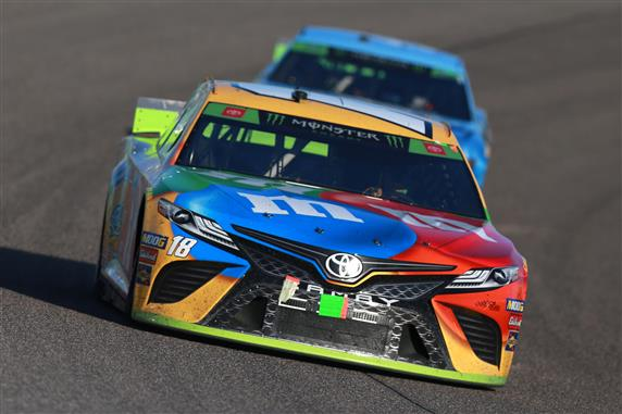 Kyle Busch leads Kevin Harvick during the Monster Energy NASCAR Cup Series Ford EcoBoost 400 at Homestead Speedway. [Sean Gardner/Getty Images]