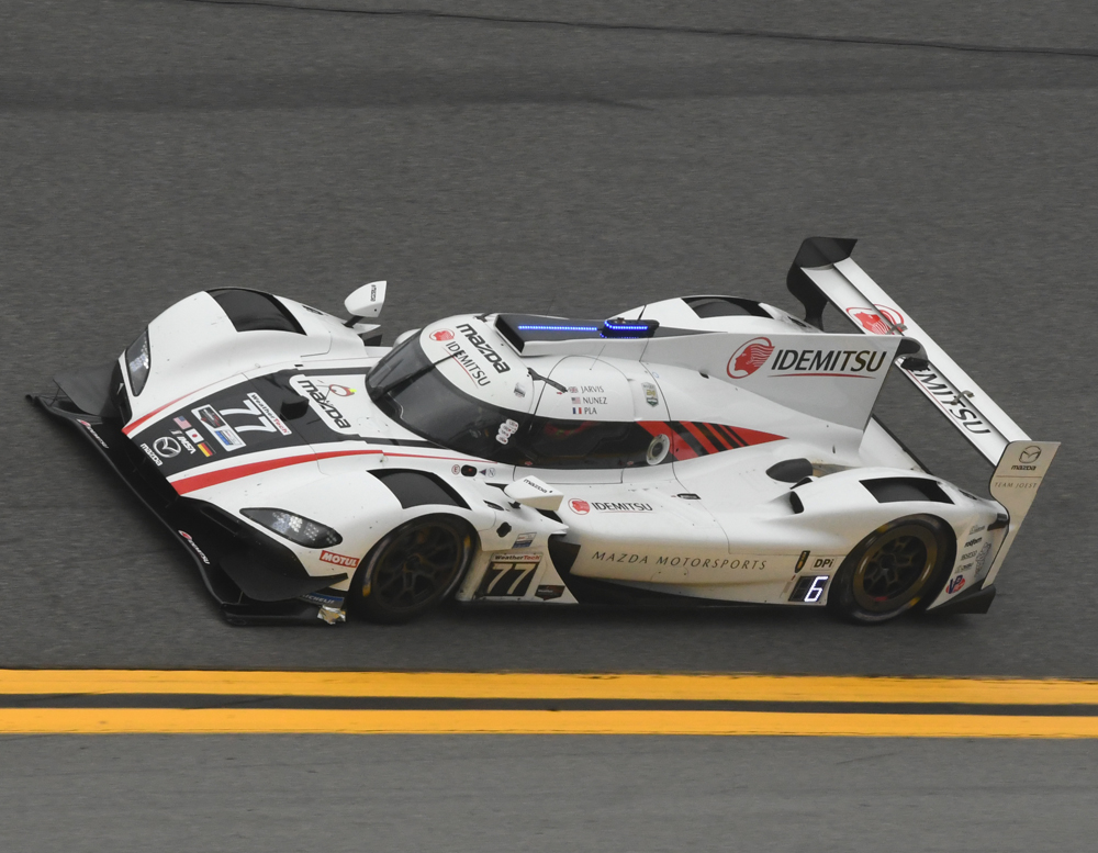 The #77 Pole winning Mazda Team Joest DPi flies through the high banks in Turn 4 at Daytona. [Joe Jennings Photo]