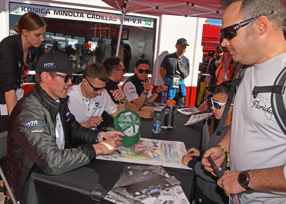 Billed as world's largest autograph party, fans lined up early to greet their favorite drivers - Scott Dixon shown with his Wayne Taylor Racing teammates. [Joe Jennings Photo]
