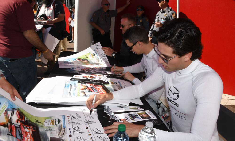 Mazda Team Joest drivers Tristan Nunez, Olovier Pla and Oliver Jarvis sign autographs. [Joe Jennings Photo]