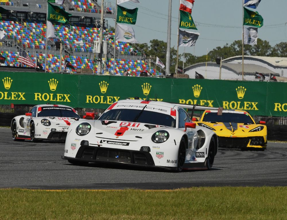 GTLM contenders Porsche 911 leads Corvette and a second Porsche 911 in tight action. [Joe Jennings Photo]