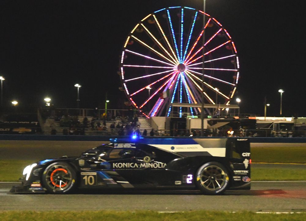 Winning Wayne Taylor Racing Cadillac in action around midnight. Take note of red-hot brakes. [Joe Jennings Photo]