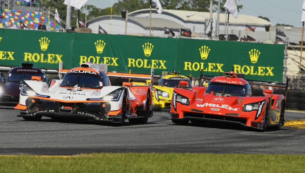 Acura Team Penske leads swarm of DPi's at start. [Joe Jennings Photo]