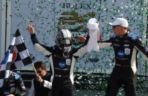 Kamui Kobayashi exits winning car and greeted by co-driver Renger van der Zende and confetti. [Joe Jennings Photo]