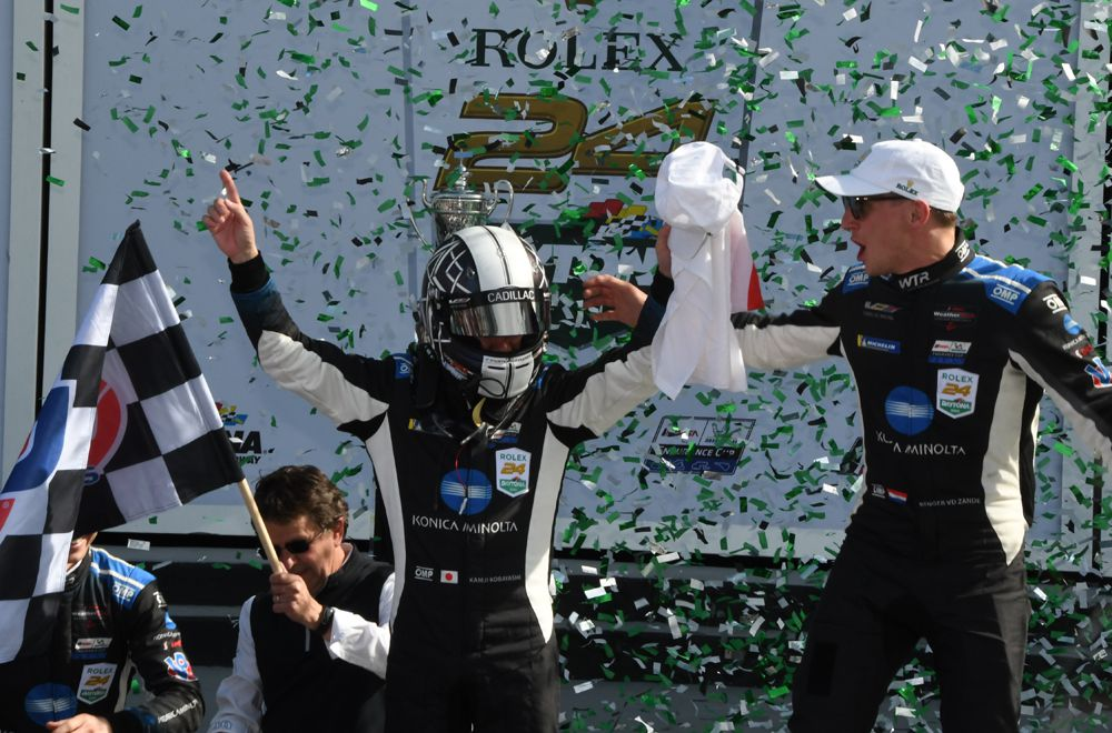 Kamui Kobayashi exits winning car and greeted by co-driver Renger van der Zende and confetti. [Joe Jennings Photo]