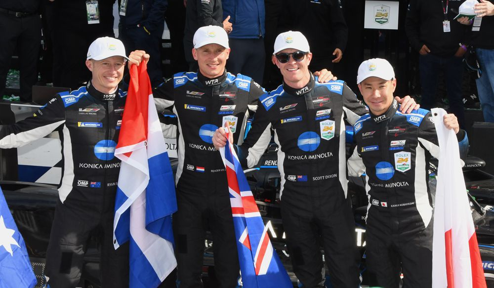 Winnning drivers with their country's flags - Ryan Briscoe, Regner van der Zende, Scott Dixon and Kamui Kobayashi. [Joe Jennings Photo]