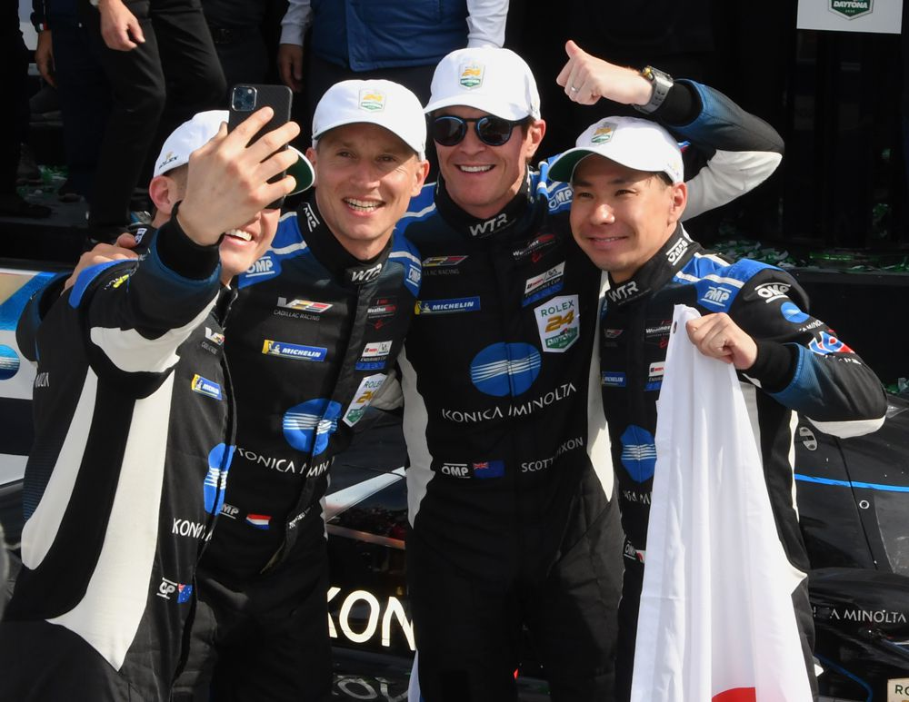 Selfie-time in victory lane - Ryan Briscoe holding phone, Renger van der Zende, Scott Dixon and Kamui Kobayashi. [Joe Jennings Photo]