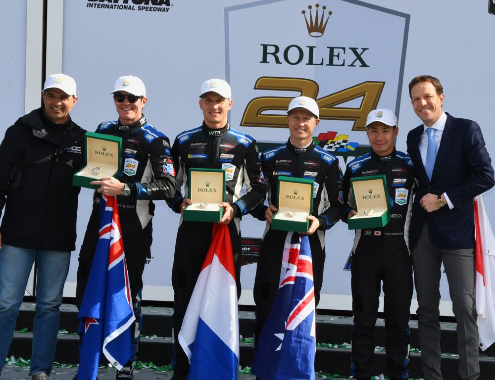 Race winners - receive the prized Rolex watches from Grand Marshall Christian Fittipaldi and Rolex executive - Scott Dixon, Renger va der Zende, Ryan Briscoe and Kamui Kobayashi. [Joe Jennings Photo]