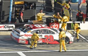 Joe Gibbs Racing crew make repairs to winning Toyota of Eric Jones.  [Joe Jennings Photo]