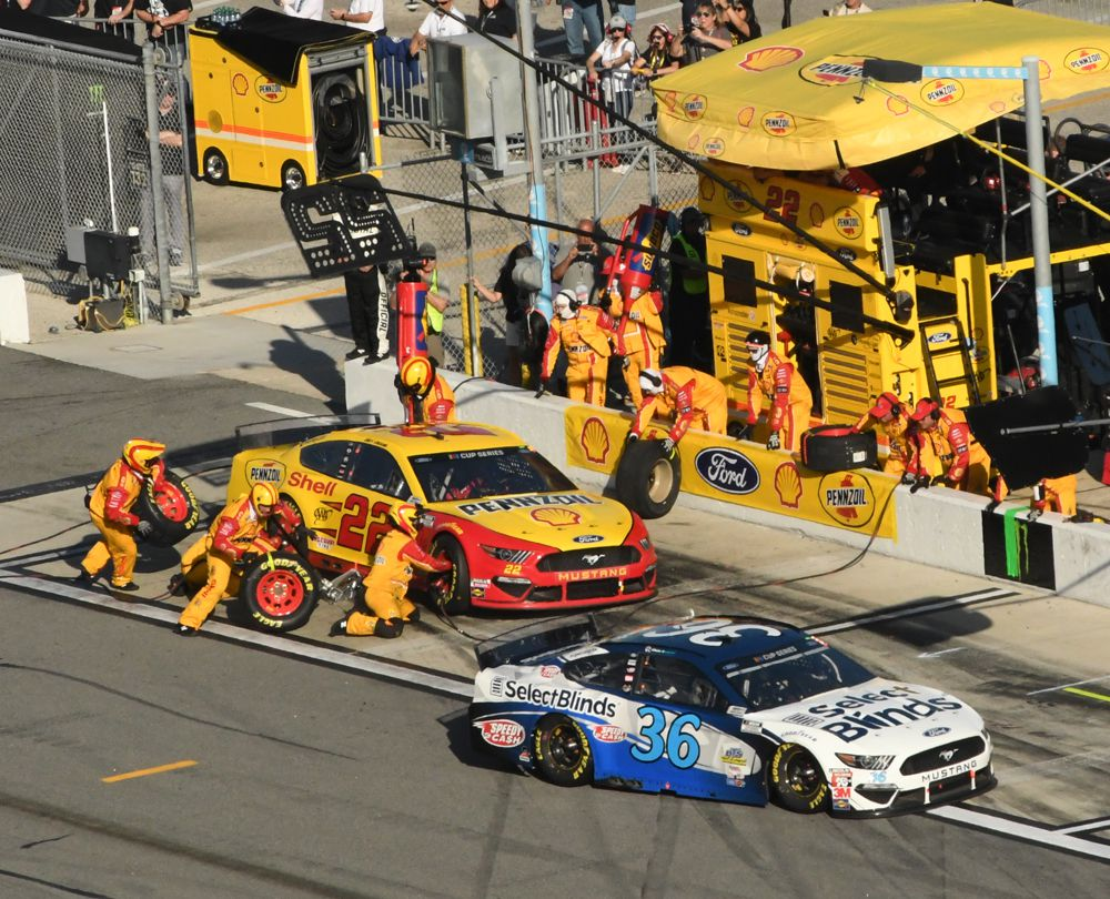 Joey Logano pits while David Ragan stops next to him. [Joe Jennings Photo]