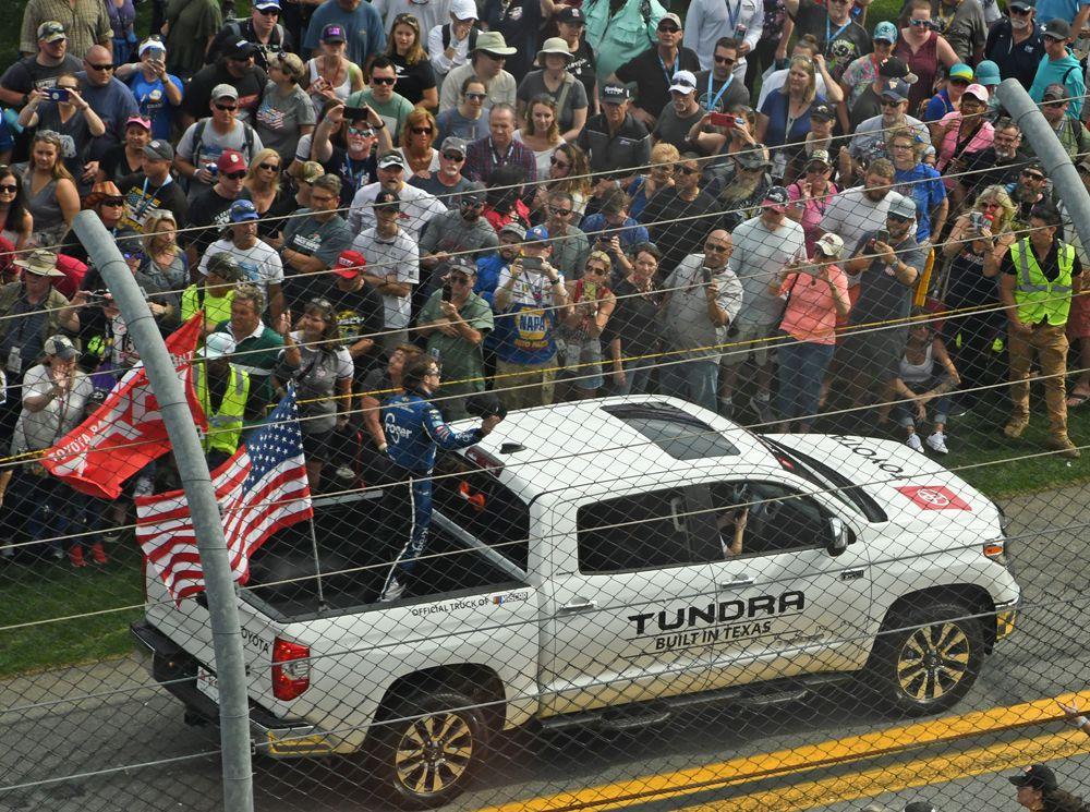 Crowd gathers to cheer for drivers in pre-race ceremonies. Pole winner Ricky Stenhouse Jr. shown here. [Joe Jennings Photo]
