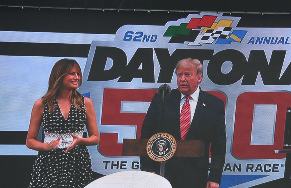 President Donald Trump and Melania Trump take to the stage for remarks prior to start of Daytona 500. [Joe Jennings Photo]