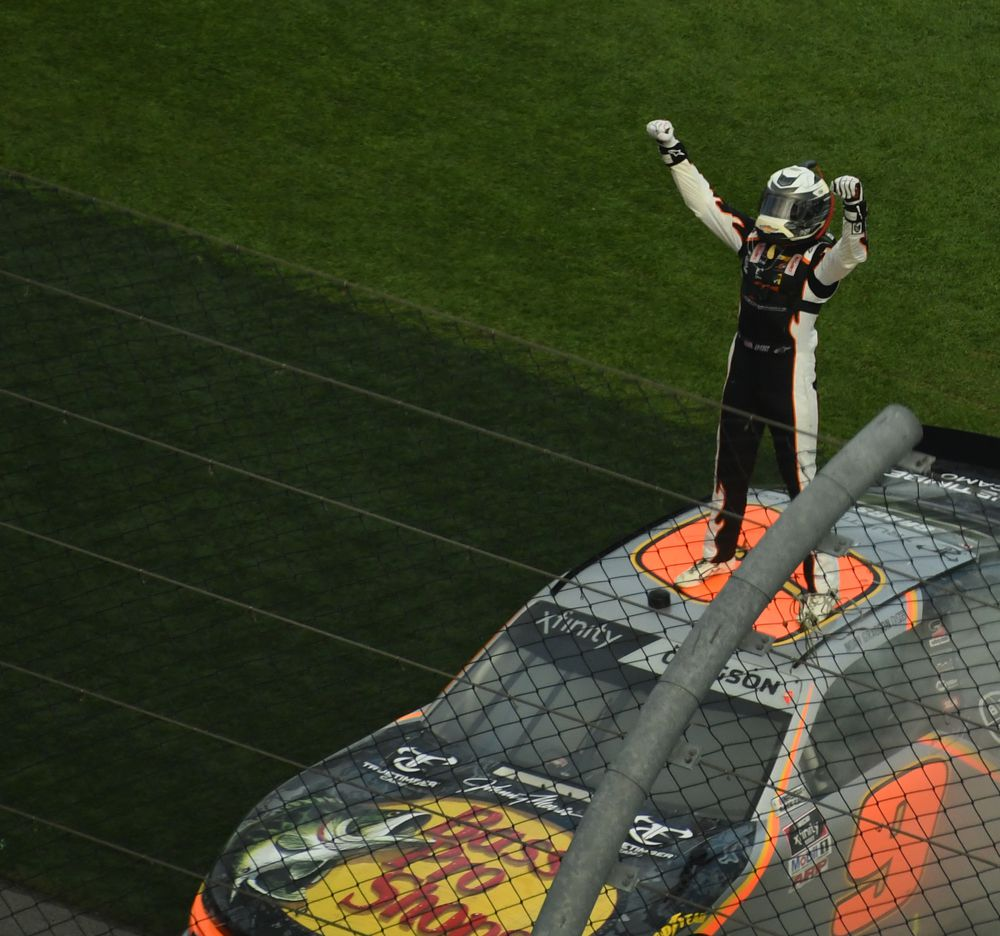 Noah Gregson salutes the Daytona crowd from atop his car. [Joe Jennings Photo]