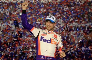 Denny Hamlin celebrates in Victory Lane after winning the NASCAR Cup Series 62nd Annual Daytona 500 at Daytona International Speedway. [Credit: Chris Graythen | Getty Images]