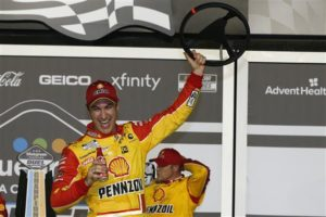 Joey Logano celebrates in victory lane after winning the NASCAR Cup Series Bluegreen Vacations Duel 1 at Daytona International Speedway. [Credit: Jared C. Tilton/Getty Images]
