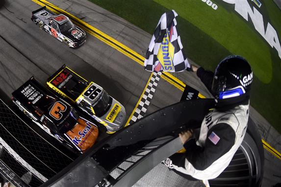 Grant Enfinger (#98) crosses the finish line ahead of Jordan Anderson to win the NASCAR Gander RV & Outdoors Truck Series NextEra Energy 250 at Daytona International Speedway. [Credit: Jared C. Tilton/Getty Images]