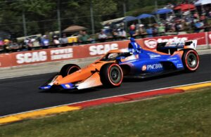 Scott Dixon races past the fans in turn five at Road America. [John Wiedemann Photo]