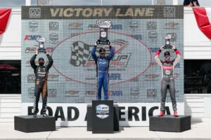 Road America REV Group Grand Prix Race 2 podium: Pato O'Ward (second place), Felix Rosenqvist (winner), Alexander Rossi (third). © [Andy Clary/ Spacesuit Media]