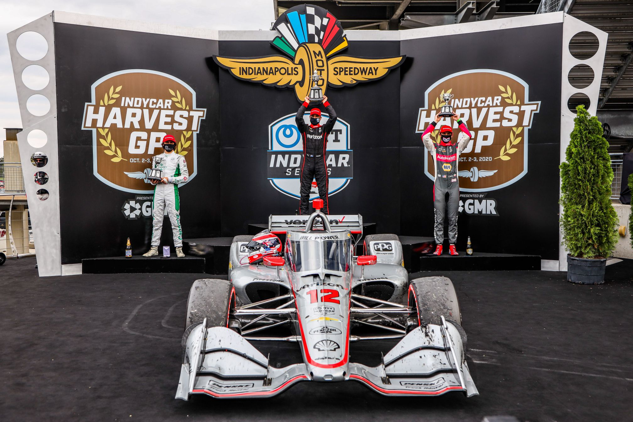INDYCAR Harvest GP Race 2 podium: Colton Herta (2nd), Will Power (winner) and Alexander Rossi (3rd). © [Andy Clary/ Spacesuit Media]