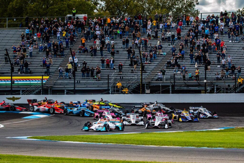 Colton Herta leads the opening lap of the INDYCAR Harvest GP Race 1. © [Kenneth Midgett/ Spacesuit Media]