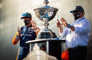 Scott Dixon and owner Chip Ganassi celebrate INDYCAR Series championship number six. © [Kenneth Midgett/ Spacesuit Media]