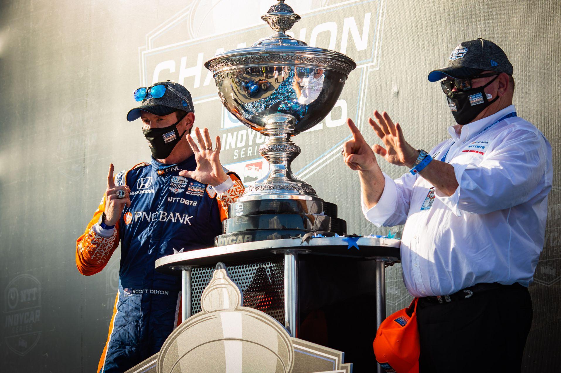 Scott Dixon and owner Chip Ganassi celebrate INDYCAR Series championship number six. © [Kenneth Midgett/ Spacesuit Media]
