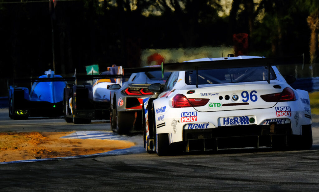 Race action exiting the hairpin. [Jack Webster Photo]