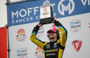 Colton Herta raises the trophy after winning the Firestone Grand Prix of St Petersburg. [Joe Skibinski Photo]