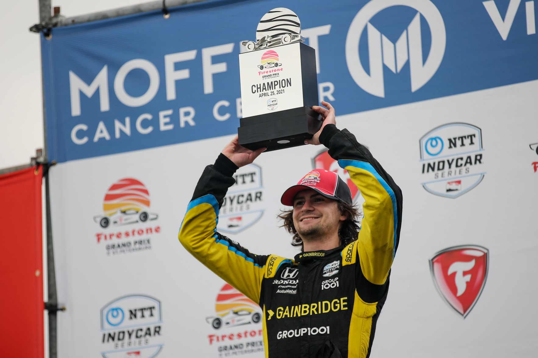 Colton Herta raises the trophy after winning the Firestone Grand Prix of St Petersburg. [Joe Skibinski Photo]
