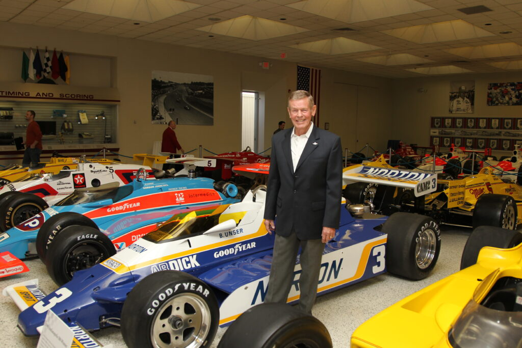 Bobby Unser next to his 1981 Indy 500 winning car. [Ron McQueeney photo]