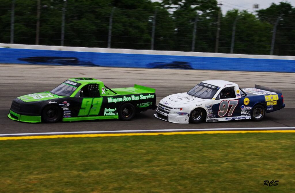 #93 Chester Ace about to be passed on last lap by winner, #97 James Swan [Roy Schmidt photo]