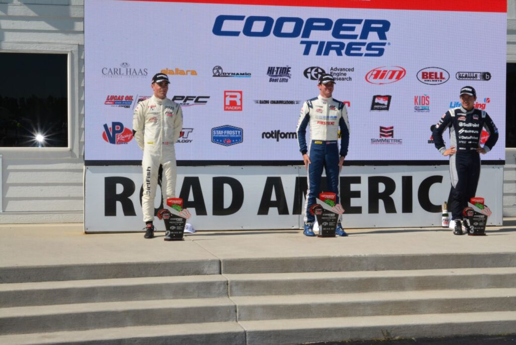 Indy Lights Race 1 Lto R: #24 Benjamin Pedersen (Colibri Capital/Ameriprise Financial/Sabelt/DirtFish) 2nd place. #28 Kyle Kirkwood (Road to Indy/Cooper Tires/ Construction Contractors Club Dallara) 1st place. #27Robert Megennis (Andretti Autosport Dallara) in 3rd place. [Dave Jensen Photo]
