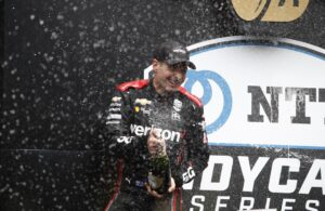 Will Power celebrates after winning the 2021 Big Machine Spiked Coolers Grand Prix at Indianapolis Motor Speedway Road Course. [Media Credit: Penske Entertainment: Chris Jones]
